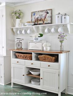 Kitchen sideboard in cottage style farmhouse with open shelving created from stock shelves from Michael's