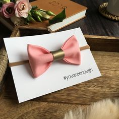 """Beautiful """"You are enough"""" new mum gift hair bow.  Perfect pick me up gift for someone in need of a little reminder that they are really are doing a fantastic job. Perfect for new mums and friends alike, anyone who needs a smile bringing to their face.  This beautiful single fabric pinch bow is set onto an extremely comfortable and stretchy one size headband, a bobble or a hair clip. #youareenough #newmom #newmomgift"""