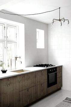 pared down simple kitchen with wood cabinets