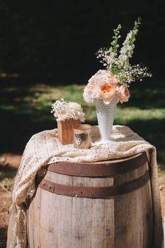 vintage vignette with wine barrel table #weddingdecor #vintage #winebarrel http://www.weddingchicks.com/2014/01/21/vintage-southern-wedding/