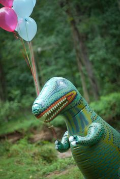 Inflatable dinosaur with balloons