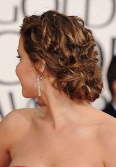 Jennifer Lawrence's Golden Globes (2013) low, loose bun. Created by Mark Townsend.