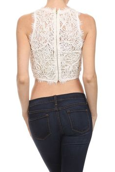 """Fully detailed design lace, crop top. 50% Polyester, 30% Cotton, 20% Rayon. MODEL INFO: Model is 5'7"""" and measures 30"""" bust, 26"""" waist, 34"""" hip. She is wearing a size small."""