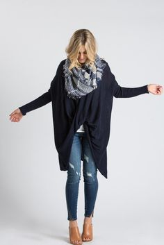 This navy surplice sweater is the one piece you NEED for chilly weather! This cozy, drapey sweater is perfect for...