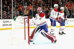 Carey Price #31 of the Montreal Canadiens hits his stick against the goal post as Shea Weber #6 and Charles Hudon #54 of the Montreal Canadiens look on after a goal by Chris Wagner #21 of the Anaheim Ducks during the third period of a game at Honda Center on October 20, 2017