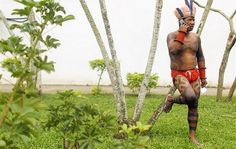 Indigenous man talks on a cellphone in the Kari-Oca village in Brazil. More than 1,000 tribal people gathered in this constructed village to protest the controversial Belo Monte dam project and Brazil's Amazon forest policies.