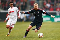 Sebastian Rode of Bayern Muenchen gets past Leonardo Bittencourt of koeln during the Bundesliga match between 1. FC Koeln and FC Bayern Muenchen held at RheinEnergieStadion on March 19, 2016 in Cologne, Germany.