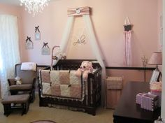 Alias Adorable Abode, Pink and brown nursery, My lil princesss nursery.  A dark chocolate chair rail was placed window-height separating a light ballet pink and almost mauve color that matches the bedding (thank you Mom and Dad).  Bedding,pictures, crib, and hamper from Target online. , Nurseries Design