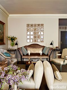 In this prewar New York City apartment, designer Suzanne Rheinstein paired two slipper chairs from Hollyhock with an Italian canapé, topped by a grid of antique engravings.   - HouseBeautiful.com
