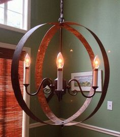 Whiskey Barrel Ring Chandelier via Etsy. This light was made from old rusty barrel rings. It will be on display at Ice and Coal Gallery in Helena, AL. Wine Barrel Crafts, Wine Barrel Rings, Wine Barrels, Ring Chandelier, Outdoor Chandelier, Chandeliers, Barrel Projects, Wine Barrel Furniture, Deco Luminaire