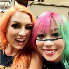 The gorgeous becky lynch and asuka looking happy.