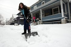 Alicia Gutierrez, 15, shovels the walk outside her home Tuesday Feb. 26, 2013 along South Main Street in Burlington, Iowa. The Burlington area saw about 4-5 inches of snow accumulation during Tuesday'