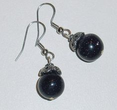 Blue Goldstone Bead Earrings with Surgical Steel Earwire and antiqued pewter bead caps These little earrings go everywhere. Great for the office. They measure about inches in total length. This is a great little earring for work or play. Bead Earrings, Beaded Necklace, Pendant Necklace, Eye Stone, Antique Pewter, White Beads, Bead Caps, Stone Bracelet, Sterling Silver Earrings