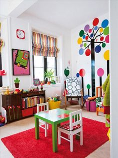 Family apartment living color  - love the tree on the wall and the bright colors