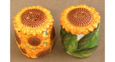 Sunflower Salt and Pepper Shakers Come in a set of White earthenware clay ceramic Hand designed and painted A removable plastic plug is located on the underside of each shaker for easy access to re Salt N Peppa, Sunflower Kitchen Decor, Earthenware Clay, Salt And Pepper Set, Salt Pepper Shakers, Orange Flowers, Cookie Jars, Sunflowers, Tea Pots