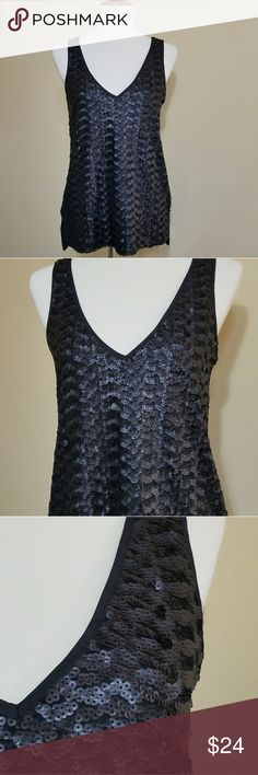 Banana Republic Black Sequins Top Sz S NWT Banana Republic Black Sequins Top Sz S NWT.  The front is black sequins while the back is solid black (no sequins). Sleeveless V-Neckline Side slits Bust: 18 inch laying flat Length: 26 inch 100% polyester Banana Republic Tops