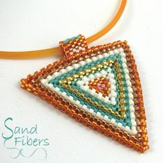 Win a Corrugated Sawtooth Kit!  Did I say I was going to post again last night? Oops...I got side-tracked with beading. I finished this new peyote triangle design - Summer Abstract