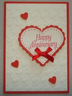 Hand made anniversary card using floating hearts embossing folder by leanne