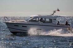 The Nimbus Boats 305 Coupe is perfectly designed for today's boater that values a social design with accommodations for an overnight trip. The Nimbus 305 Coupe may be the smallest of the Coupe series, but certainly feels like a much larger boat. Yacht For Sale, Social Activities, Boater, Power Boats, Larger, Bathing, Seattle, Feels, Deck