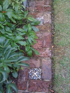 Garden Border. No directions, but a cute idea. Looks easy to do.  Bricks in design with artful varied centers that could repeat.  Fun!