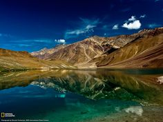 The azure waters of Chandra Tal—Lake of the Moon—in Himachal Pradesh, India, reflect the vivid hues of a bright Himalayan day. Description from imagesphotogallery.blogspot.it. I searched for this on bing.com/images