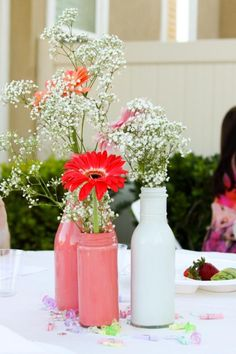 Gerbera Daisies look fun and festive showcased with Baby's Breath. The painted jars/containers pull the colors and finish off the whole look. Shop Gerbera Daisies and Baby's Breath year-round at GrowersBox.com!