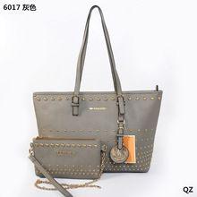 2014 New Rivet Ženy Kabelky európskych a amerických Style Fashion Big Bag Slávne Určené Ženy Tašky cez rameno Doprava zdarma (Čína (pevninská časť))