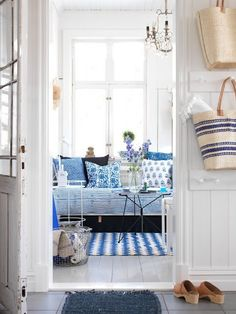 Dream home beach cottage seaside retreat blue and white interior tt Think of using beach baskets for the condo Coastal Cottage, Cottage Homes, Cottage Style, Coastal Style, Coastal Entryway, Coastal Living, Coastal Rugs, Seaside Style, Coastal Bedding