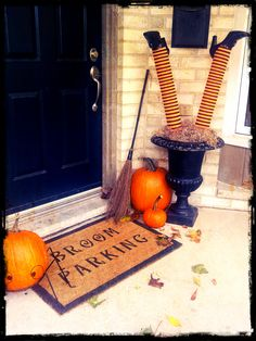Halloween Front Door: Halloween DIY painted welcome mat using @Benjamin_Moore exterior Aura paint. Created by @LeighAnnAllaire, as seen on www.cityline.ca Witch legs created with pool noodles, thrift store shoes, and dollar store nylons