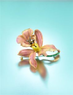 """An Art Nouveau Yellow Gold, Polychrome Enamel, Diamond and Emerald """"Style No. 4: Calanthe Veitchii"""" Orchid Brooch, Paulding Farnham for Tiffany & Co., Circa 1890"""