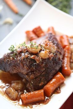 Braised beef brisket is slow cooked with vegetables and a perfect sweet and savory sauce: a perfectl dinner and it couldn't be simpler! lemonsforlulu.com #RecipeSerendipity #recipe #food #cooking