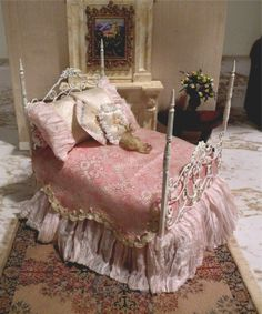 Dollhouse Miniature 1:12 Scale Artisan Dressed Wrought Iron Bed. $85.00, via Etsy.