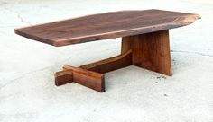 - $1,100                     A unique cantilever design in live edge wood offers eye catching detail in a solid, strong occasional table off...