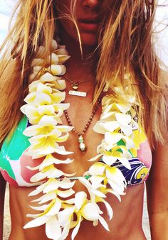 May Day is Lei Day in Hawaii.and I LOVE it. I made this little beauty today, and yes, it smells heavenly. Wearing it now as I type. Bikin by San Lorenzo // Beach bling byLong Lost Jewelry(shark), Kate Davis(Beach Bum) and Amy Grace (black pearl).
