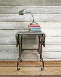 Vintage Industrial Typewriter Table -- Vintage Metal Table. $95.00, via Etsy.