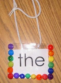 teacher wears sight word necklace throughout the day. Kids have to assess at certain points during the day.