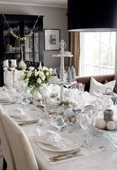 Winter and New Years tablesetting. Decorated in white and light blue, giving it a feeling of a icy winter. Accompanied by white roses. For more pictures and inspiration, please visit my interior blog: http://anettewillemine.com/
