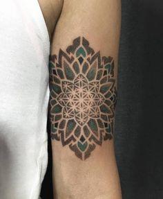 Mandala tattoo on the left bicep. Tattoo Artist: Corey Divine