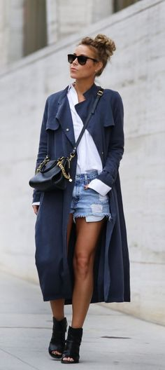 Mary Seng is wearing a blue duster, white shirt from Alexander Wang, denim shorts and sandals from Rag & Bone