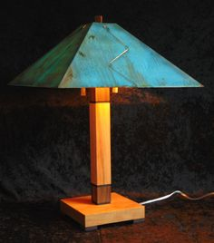 """The Chicago Lamp Available in 26"""" and 60"""" Shown in cherry with walnut trim and green copper patina shade"""