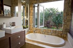 Here we share best 23 Natural Bathroom Decorating Pictures. Would you like to bring nature inside your bathroom ? Let the natural world into your bathroom. Bathroom Decor Pictures, Natural Bathroom, Surabaya, Travertine, Corner Bathtub, My House, Indoor Outdoor, The Good Place, Interior