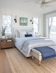 white upholstered bed lake house master bedroom blue and white bedroom, coastal bedroom decor with sconces and shiplap, jute rug and blue bedding, lake house bedroom decor, coastal bedroom decor Master Bedroom Design, Home Decor Bedroom, Bedroom Ideas, Bedroom Designs, Master Suite, Bedroom Tv, Bedroom Wallpaper, Bedroom Lamps, Bedroom Lighting