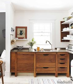 A fresh design inspired by the clean and practical warmth of Scandinavian style in this New York kitchen. Designer Susan Serra creates a peaceful space that plays with dark and light.   - HouseBeautiful.com