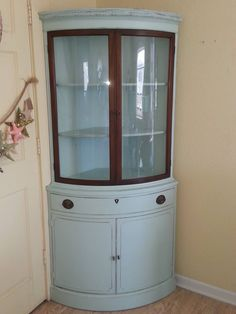 Vintage corner cabinet with curved glass. Custom specs by client request.