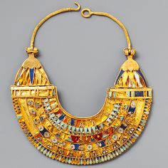 Miniature broad collar Period: Macedonian and Ptolemaic Period Date: B. Geography: Country of Origin Egypt, Eastern Delta; Probably from Tukh el-Qaramus Medium: gold, carnelian, turquoise, lapis lazuli Dimensions: h. Ancient Egyptian Costume, Ancient Egyptian Jewelry, Egypt Jewelry, Jewelry Art, Antique Jewelry, Gold Jewelry, Lapis Lazuli, Ancient Artifacts, Jewelery