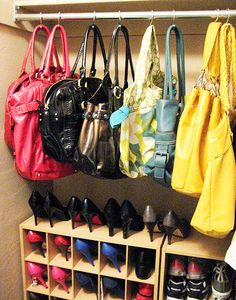 shower curtain hook handbag hangers -- smart organization. Could also use for pots in kitchen.