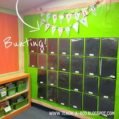 this teacher's work display wall is with sheet protectors! Great idea...