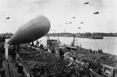 Barrage balloons were used to protect against enemy air attack as more troops landed on beaches. 70th Anniversary, Anniversary Photos, D Day Landings, Lest We Forget, Normandy, Looking Back, World War Ii, Troops, Beaches