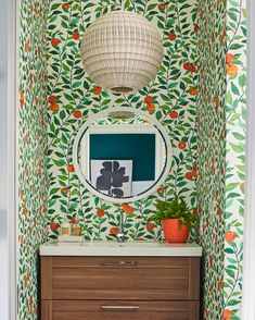 """In this nursery bathroom by from our August """"Color"""" issue, a vibrant wallcovering depicting oranges adds depth and dimension. The vanity is from IKEA. 📷: Styled by: . Paint Cabinets White, Painting Cabinets, August Colors, Colorful Throw Pillows, Interior And Exterior, Interior Design, Wall Molding, Atlanta Homes, Wall Treatments"""