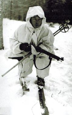 Winter War. Finnish soldier advancing with ski poles tucked under his arm.